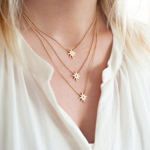 Guiding Star Birthstone Necklace in Gold Plated Layered with other Guiding Star Birthstone Necklaces