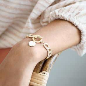 gold plated curb chain and disc statement bracelet