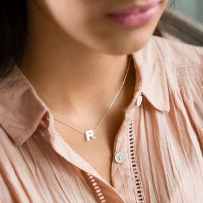 Mother of Pearl letter charm necklace on a silver chain