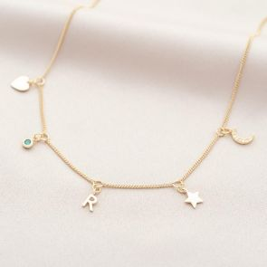 multi charm necklace with birthstone and letter charm in gold plated