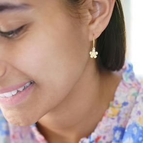 flower charm hoop earrings available in sterling silver and gold plated sterling silver