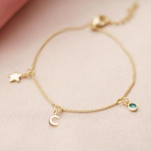 triple charm bracelet personalised with letter and birthstone charms in champagne gold